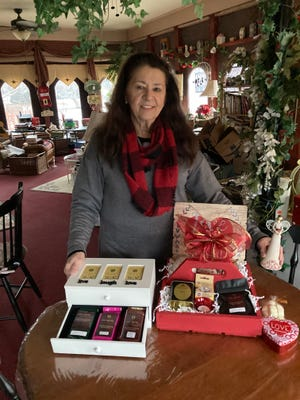Marlena Allen puts together baskets and gift boxes.