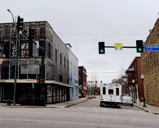 A city transit bus passes the empty Goins Furniture building at 900 Garrison Avenue, Tuesday, Jan. 1, in downtown Fort Smith.