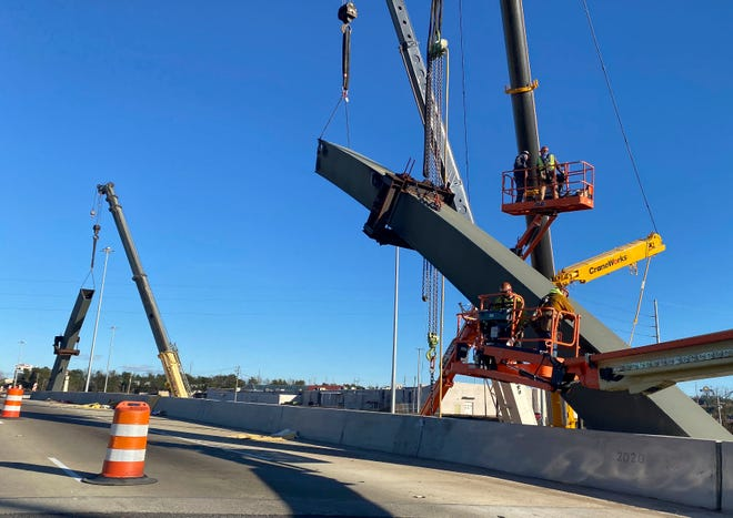 A construction crew removes the steel arch from the southern side of the McFarland Blvd. overpass on Interstate 20/59 Saturday, Jan. 16, 2020. [Staff Photo/Gary Cosby Jr.]