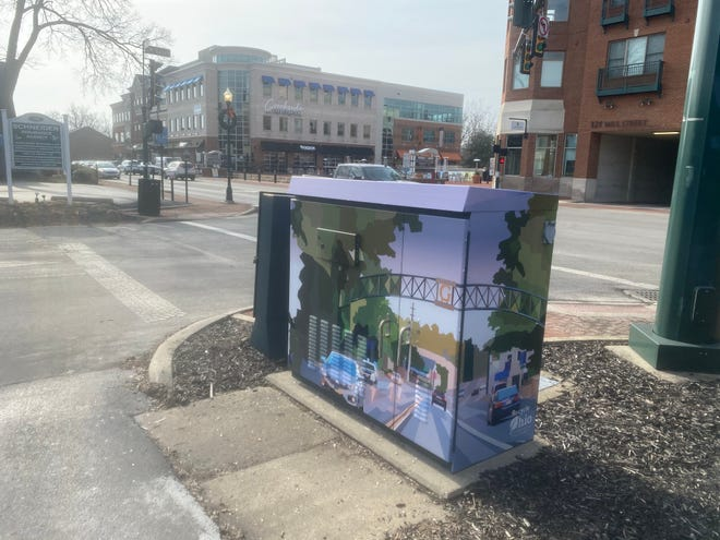 Gahanna Lincoln High School senior Jason Raymond designed the vinyl wrap for a utility box at Mill and Walnut streets, across from the Creekside parking garage's entrance. He created the design as a student in the School to Work Advanced Graphics class.