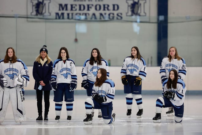 Medford girls hockey starters pose for a photo before the start of a game versus Marblehead at LoConte Rink on Saturday, Jan. 16.