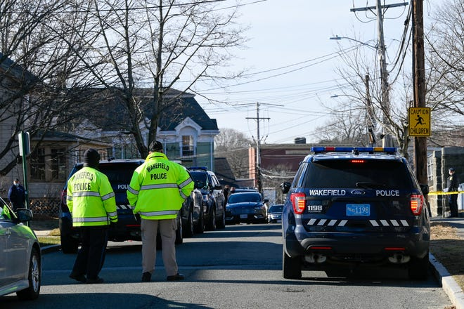 Wakefield Police investigate a homicide and police-involved shooting at a home on Otis Street on Tuesday, Jan. 19, 2021.
