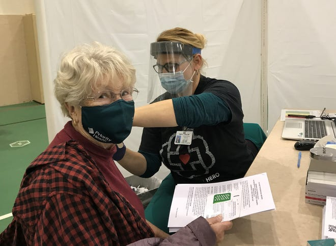 Diana Anderson, 83, of Vicksburg, MI, is vaccinated against the coronavirus on Saturday, Jan. 16, 2021, at the Bronson Fieldstone Center in Battle Creek.