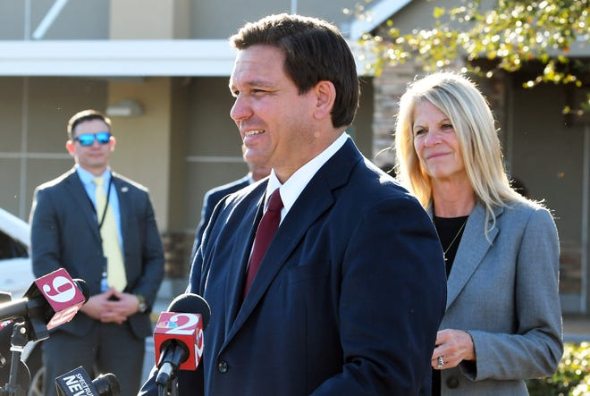 Florida Gov. Ron DeSantis holds a news conference Tuesday in the parking lot at the Publix at Stadium Corners in Viera. At right is Florida Senate Majority Leader Debbie Mayfield.