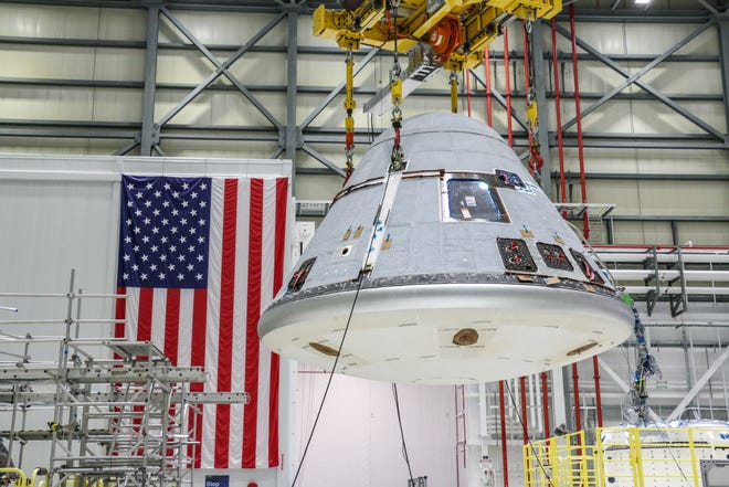 In January, the Orbital Flight Test-2 crew module was lifted and moved in the Starliner production factory at Kennedy Space Center in Florida prior to Weight and Center of Gravity testing.