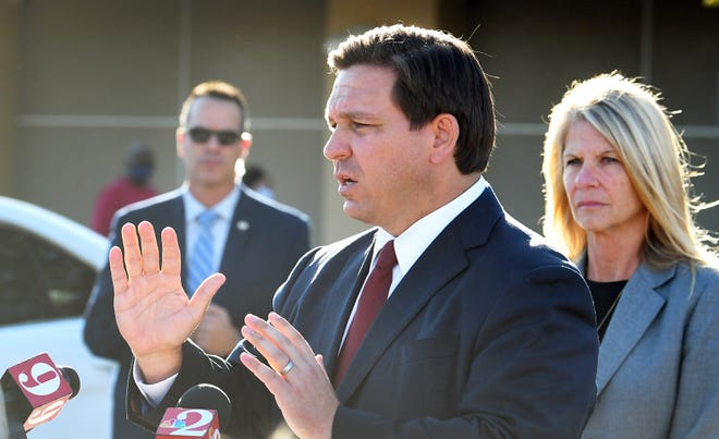 Florida Gov. Ron DeSantis speaks at a Jan. 19 news conference in the parking lot at the Publix Super Market at Stadium Corners in Viera. His news conference in Port Charlotte on Thursday took on a more confrontational approach.