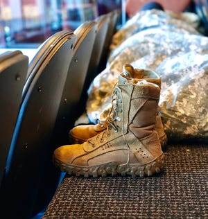 A member of the Vermont Army National Guard's 172nd Cavalry Regiment, 86th Infantry Combat Team (Mountain) rests inside a suite at FedEx Field in Maryland on Jan. 19, 2021, while deployed to support security for the inauguration of President-elect Joe Biden.