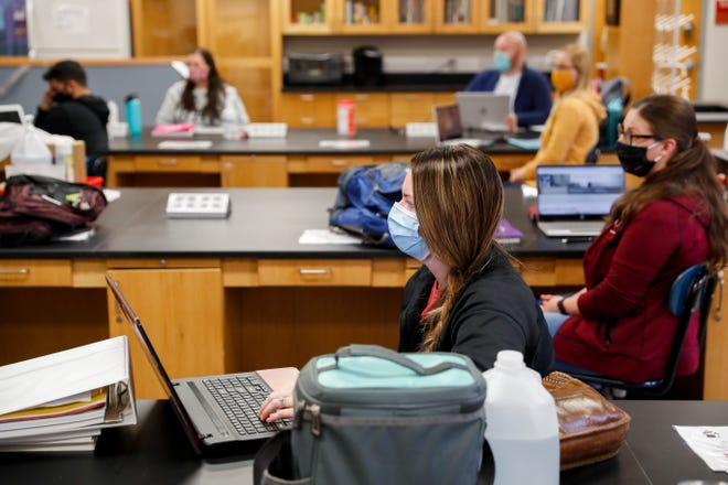Makinna Little listens to assistant professor Tim Catalano help the students prepare for an exam in their radiation therapy program on the first day of in-person classes at the Sundquist Science Complex in Clarksville, Tenn., on Tuesday, Jan. 19, 2021.