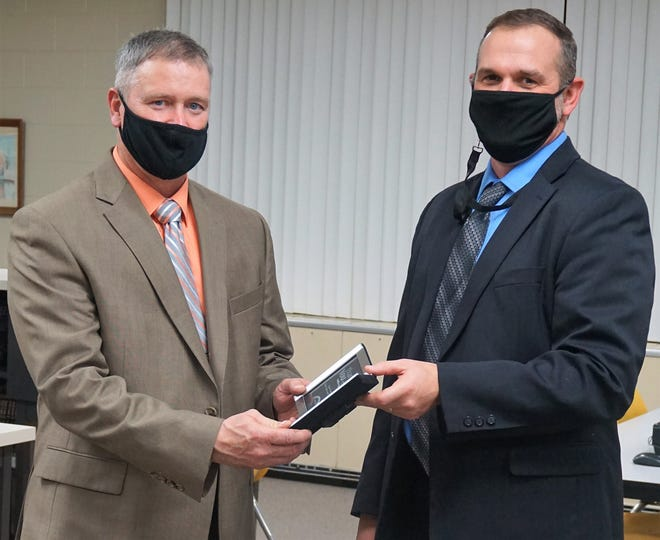 Steve Foster, a 30-year employee of River View Local Schools, receives the Hero Award from Superintendent Dalton Summers. The honor from the Coalition of Rural and Appalachian Schools recognizes employees who go above and beyond in their service to their community and school district.