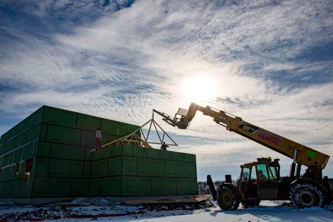 Homes under construction in the Harvest Ridge subdivision in Ankeny Monday, Jan. 18, 2021.