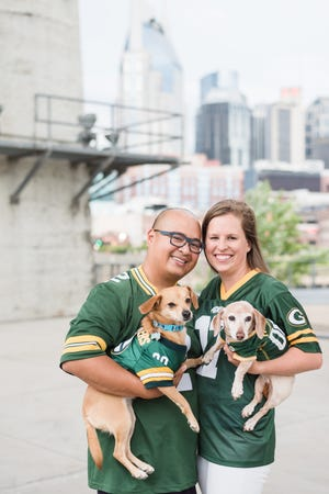 Cheering for the Packers from their home in Nashville is a family affair for Madison native Joseph Salvo, his wife, Kelly, and their two dogs, Harmony and Ella.