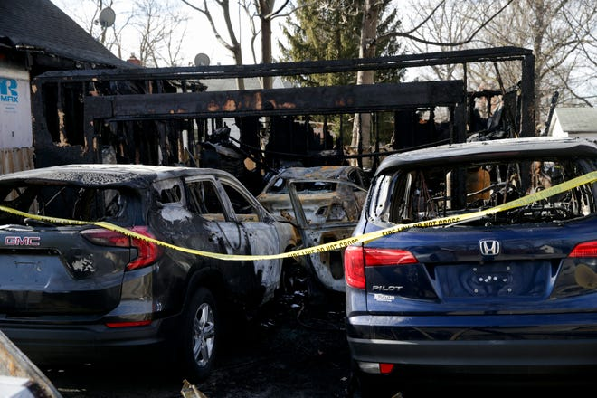 Several damaged vehicles are seen in the remnants of a detached garage of a home on the 1900 block of Charles Street, Tuesday, Jan. 19, 2021 in Lafayette. The Lafayette Fire Department says a knocked over space heater started the fire early Saturday morning. Four vehicles were damaged and two neighboring homes received damage from the heat of the fire.