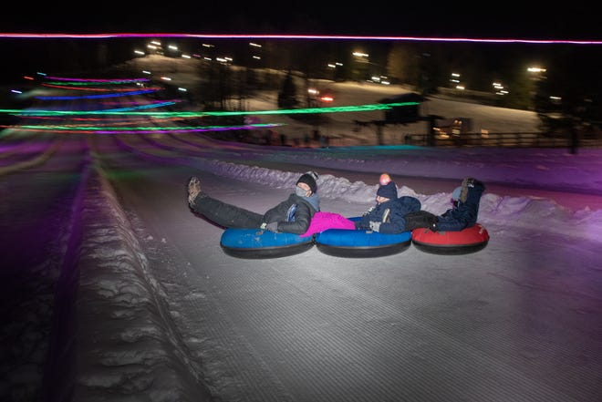 Guests take part in glow tubing at a previous Will Tube for Food event at Snow Trails. This year's benefit is Wednesday.