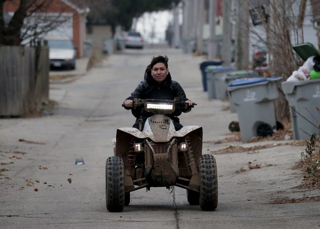 Jose Olalde takes his ATV on a test ride in Milwaukee. The village of Hartland recently considered allowing ATVs on certain roadways, but ultimately decided against it.