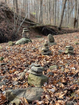 Rock stacks are shown at Red-tail Land Conservancy's nature preserve, Fall Creek Woods