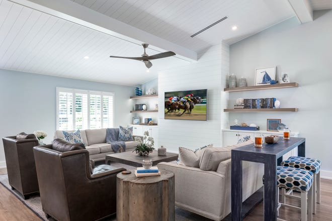 Jinx McDonald Interior Designs, Inc. (JMID) redesigned a North Naples home into a fun, fresh space that's ideal for friends and family to watch a game.