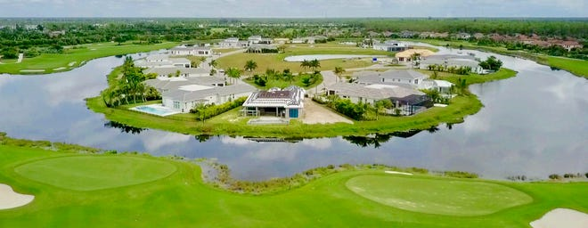 Every home in Peninsula at Treviso Bay offers a lake view with the fairways and greens of the community's TPC golf course beyond.