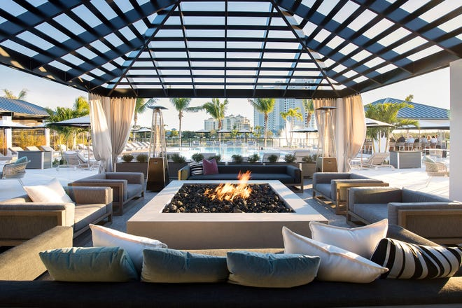 The residents of Kalea Bay enjoy gathering around the high-rise community's fire pits both day and night.