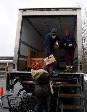 Susan, Peter, and Sally Leithauser load donations on to a box truck during the annual Feed the Dream food drive on Monday, Jan. 18, 2021 at Ross' Granville Market. The annual food drive in observance of Martin Luther King Jr. Day serves the Food Pantry Network of Licking County through food and monetary donations collected on and around the holiday.