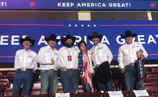In a photo posted to her campaign's Facebook page, U.S. Rep. Yvette Herrell, then a candidate, poses in the center of a group photo with members of the Cowboys For Trump group at President Donald Trump's rally in Rio Rancho, N.M. on September 16, 2019. Herrell, center, is next to group founder Couy Griffin on her left.