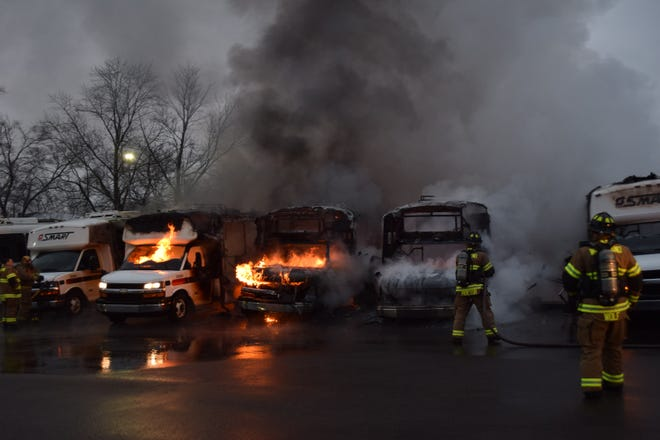 Firefighter work to extinguish the fire that destroyed several SMART buses Jan. 18, 2021.