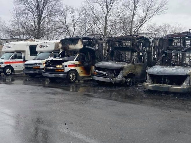 Fire destroyed buses outside Nankin Transit in Westland the morning of Monday, Jan. 18, 2021.