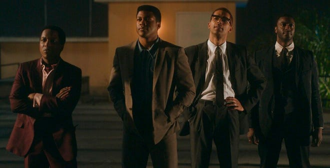 """This image released by Amazon Studios shows Leslie Odom Jr., from left, Eli Goree, Kingsley Ben-Adir and Aldis Hodge in a scene from """"One Night in Miami."""" (Amazon Studios via AP)"""