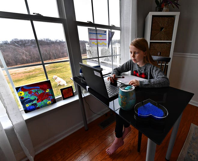 Dallastown Intermediate School fourth-grader Ava Montour, 9, sits at her desk in the family dining room while remote learning with her class from her home in Springfield Township, Tuesday, Jan. 19, 2021. Dawn J. Sagert photo