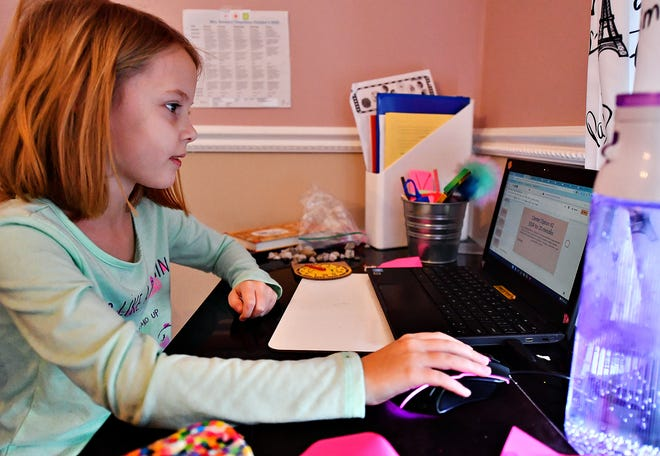Loganville Springfield Elementary third-grader Olivia Montour, 8, sits at her desk in the corner of her bedroom while remote learning with her class from her home in Springfield Township, Tuesday, Jan. 19, 2021. Montour's mother, Jessica Montour, not pictured, realized that her daughters needed individual learning space and moved her elder daughter, Ava, 9, to the dining room. Dawn J. Sagert photo