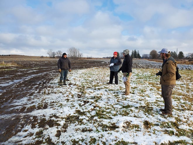 Participants in a Western Wisconsin Conservation Council field day in November discuss the benefits of grass waterways.