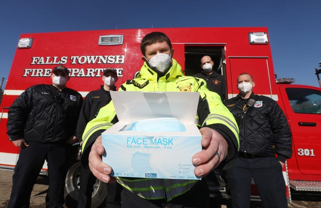Falls Township Fire Depertment EMT personnel operate under the assumption that every patient potentially has COVID-19, and wear masks on each run. If a patient doesn't have one, they keep plenty of spares. Pictured are firefighter/EMT Brandon Smith, left, FF/EMT Tyler Crouse, FF/EMT Austin Settles, Chief and Paradamedic Brady Johnson and Lt. and Paramedic Waylon Clark.