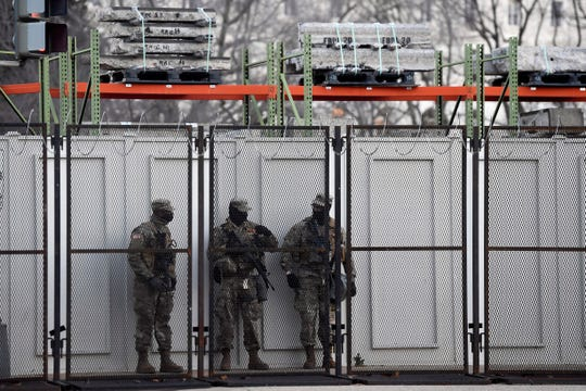 National Guard troops stand guard along the Capitol complex on Monday. Security preparations continue around the Nation's Capitol in preparation for the inauguration of President-elect Joe Biden and Vice President-elect Kamala Harris.
