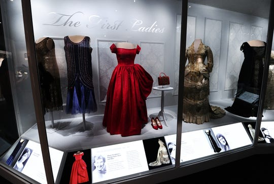 """Dresses and accessories of former first ladies are displayed at the Smithsonian's National Museum of American History in Washington, DC, on Nov. 18, 2011, during a media preview of """"The First Ladies,"""" a major new exhibit showcasing objects from the century-old First Ladies Collection."""