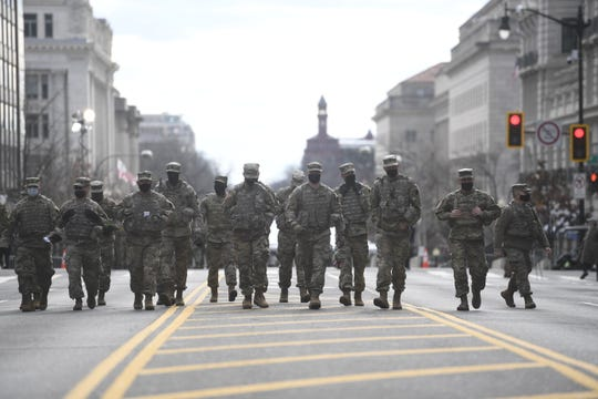 National Guard troops from Pennsylvania march up 14th Street in downtown Washington, DC on Jan. 18, 2021.