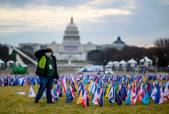 "Thousands of flags creating a ""Field of Flags"" are seen on the National Mall."