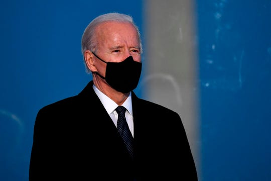US President-elect Joe Biden attends a Covid-19 Memorial at the Lincoln Memorial in Washington, DC, on January 19, 2021 to honor the lives of those lost to Covid-19.