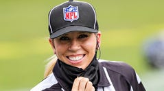 Down Judge Sarah Thomas takes the field before a game this season between the Pittsburgh Steelers and the Tennessee Titans.