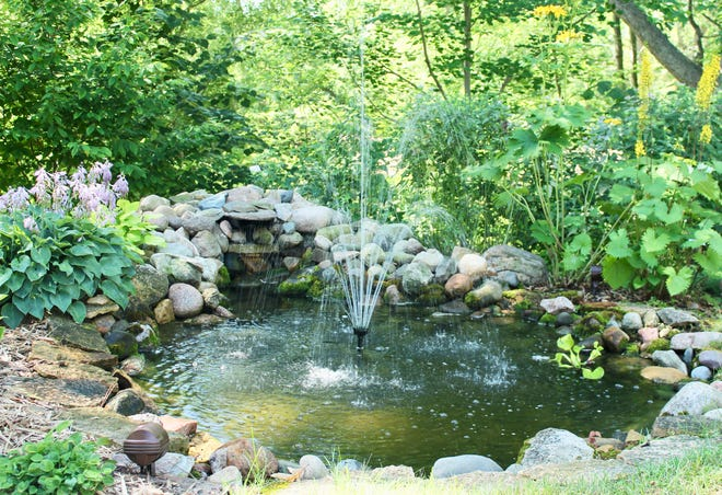 For a more permanent structure, you can create a pond with a fountain surrounded by rocks.