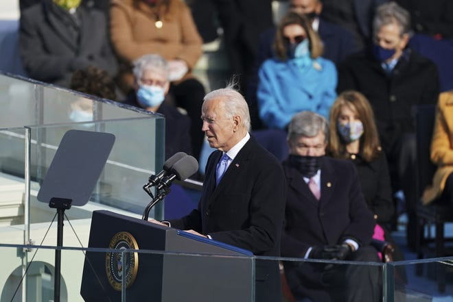 President Joe Biden delivers his inaugural address after he was sworn-in as the 46th President of the United States on the West Front of the U.S. Capitol in Washington, Wednesday, Jan. 20, 2021.