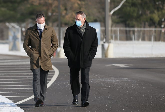 Steve Wood, Chief Operations Officer at Tallmadge Schools  and retiring Tallmadge Superintendent Jeff Ferguson walk to the Tallmadge Middle School on Tuesday, Jan. 19, 2021. Wood will be the new Tallmadge Superintendent when Ferguson retires at the end of the month.  [Mike Cardew/Beacon Journal]