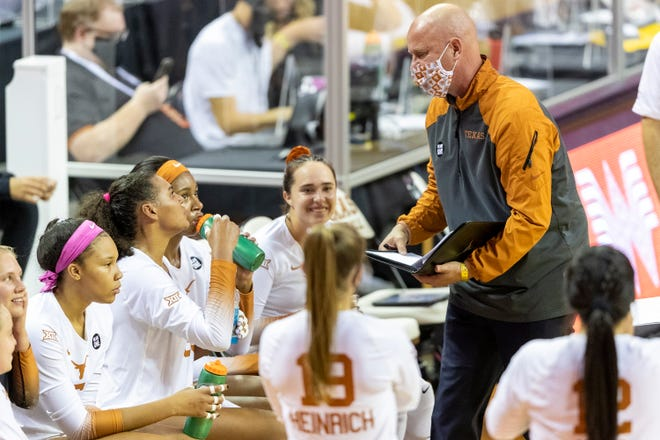Texas head coach Jerritt Elliott speaks with his team in a time out against Iowa State during a Big 12 volleyball match at the Erwin Center, Thursday, Oct. 8, 2020. [Stephen Spillman for Statesman]