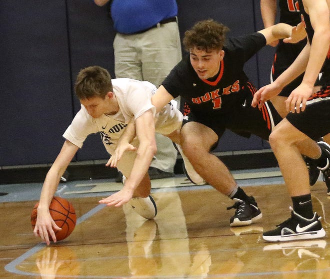 Louisville's Tyler Boldon, left, and Marlington's Macagey Laure, going for a loose ball during action at Louisvlle High School on Tuesday, January 19, 2021.