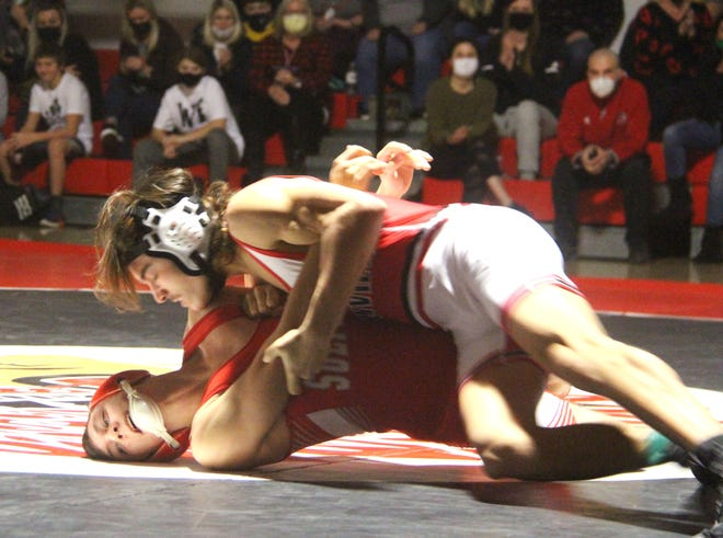 Plainview's Blane Gibbs, top, works a move against Sulphur's Luke Norton on Tuesday night at 132 pounds. Gibbs notched a pin to help the Indians tally a 54-21 win.