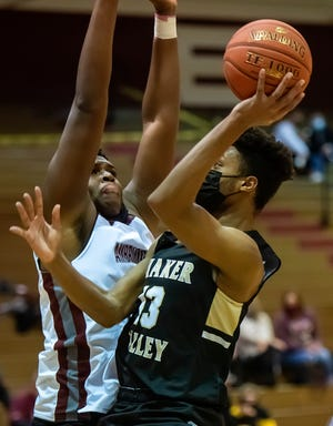 Quaker Valley's Markus Frank tries to shoot around Ambridge's Enire Bowens during their game Tuesday at Ambridge Area High School.