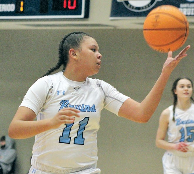 Bartlesville High freshman Mikka Chambers tries to get the handle on the ball during varsity girls basketball action Tuesday at the Bruin Fieldhouse. Ponca City hung on to beat Bartlesville, 42-39.