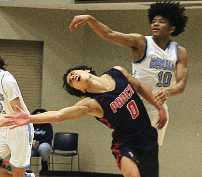 Bartlesville High School freshman David Castillo, right, and a Ponca City High guard collide during Tuesday's varsity basketball battle at the Bruin Fieldhouse. Castillo finished with 43 points in the 74-66 victory.
