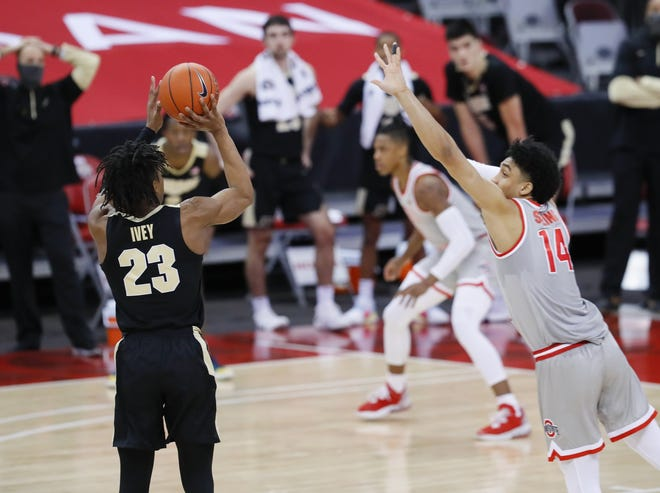 Purdue guard Jaden Ivey launches the game-winning three-point basket in front of Ohio State's Justice Sueing in the Boilermakers' 67-65 victory on Tuesday.