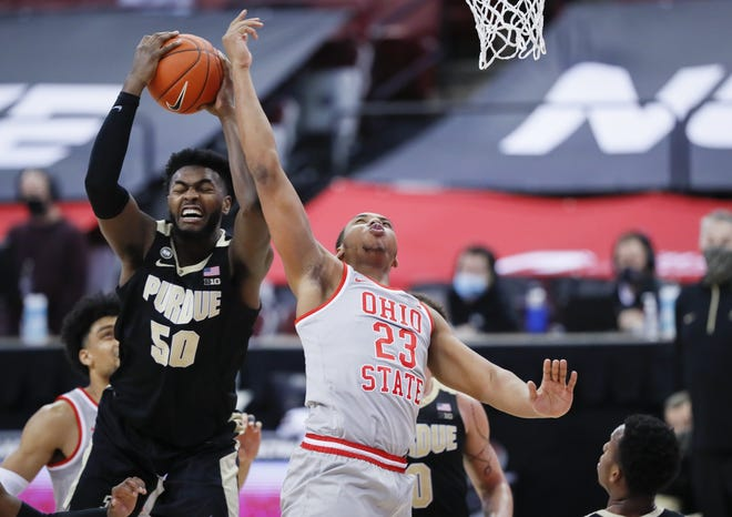 Purdue Boilermakers forward Trevion Williams (50) grabs a rebound away from Ohio State Buckeyes forward Zed Key (23) during the first half of the men's basketball game at Value City Arena in Columbus on Tuesday, Jan. 19, 2021.