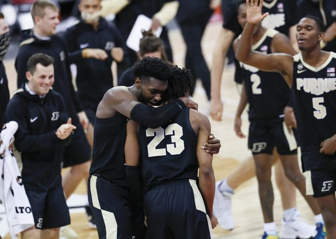 Purdue Boilermakers guard Jaden Ivey (23) gets a hug from forward Trevion Williams (50) as they celebrate the 67-65 win over Ohio State Buckeyes in the men's basketball game at Value City Arena in Columbus on Tuesday, Jan. 19, 2021. Ivey hit a three pointer in the final seconds of the game to claim the victory.