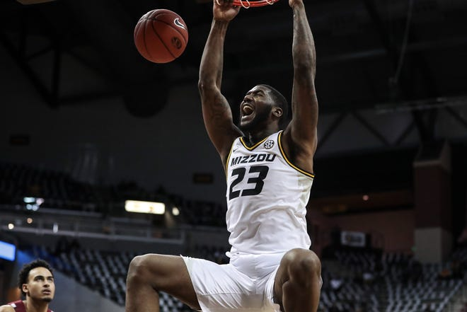 Missouri forward Jeremiah Tilmon (23) dunks the ball during a game against South Carolina on Jan. 19 at Mizzou Arena.